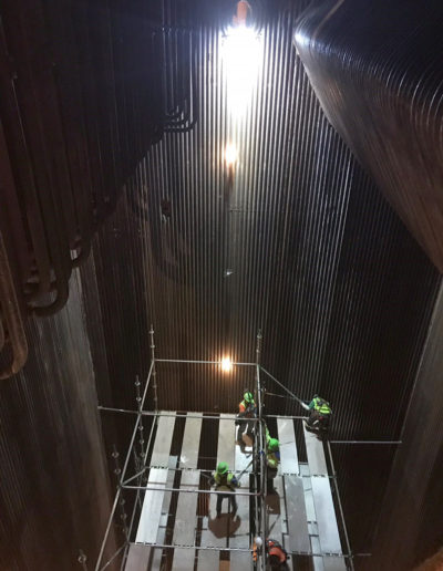 The BRICK lighting inside Large Boiler with scaffolding workers